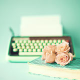 Roses and typewriter stock photography