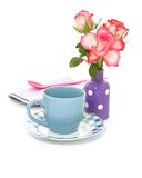 Roses in vase and cup isolated on white Stock Photo