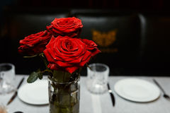 Roses in a vase on a table. In a restaurant Royalty Free Stock Photo