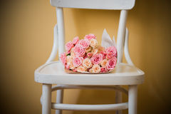 Roses on vintage chair Stock Photography