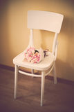 Roses on vintage chair Royalty Free Stock Photography