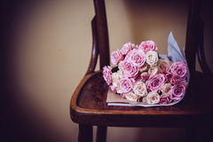 Roses on vintage chair Royalty Free Stock Images