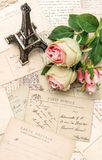 Roses, vintage postcards and souvenir Eiffel Paris Stock Image