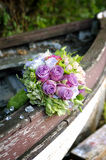 Roses  wedding bouquet on the motor boat Royalty Free Stock Photography