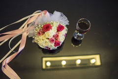 Roses wedding bouquet on the table Stock Photography