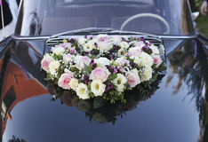 Roses on wedding car Royalty Free Stock Photos