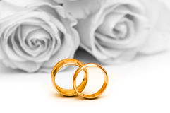 Roses and wedding ring Stock Images