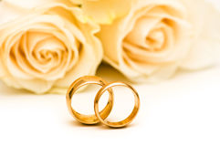 Roses and wedding ring Stock Photos