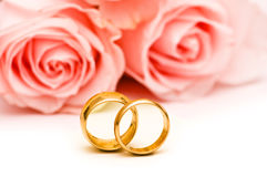 Roses and wedding ring isolated Stock Photos