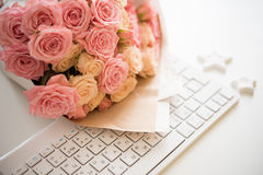Roses on white computer keyboard Royalty Free Stock Image