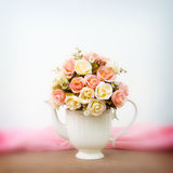 Roses in white  jug on wooden table and blur background Stock Images