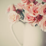 Roses in white vase. Vintage roses in a white vase royalty free stock photos