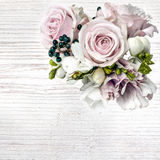 Roses on white wooden board background. Delicate pastel roses on white wooden board Royalty Free Stock Image