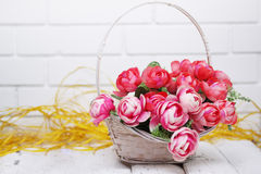 Roses in a wicker basket. Beautiful artificial roses in a wicker basket Stock Photography