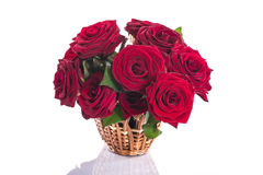 Roses in a wicker basket Stock Images