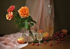 Roses, wine, apples and gooseberries Royalty Free Stock Photo