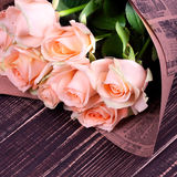 Roses on wooden background. Roses bouquet over wooden background Stock Photos