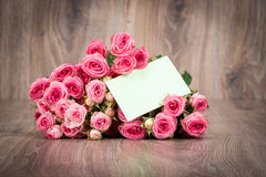 Roses on wooden background Royalty Free Stock Photo