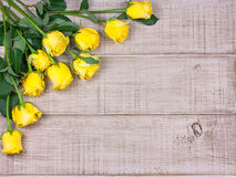Roses on wooden background. With space for text Royalty Free Stock Image