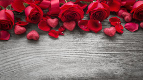Roses on wooden board Stock Images