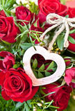 Roses with a wooden heart Royalty Free Stock Image