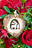 Roses with a wooden heart Stock Photos