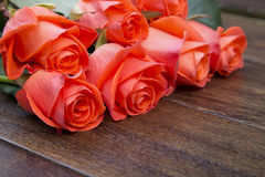 Roses on a wooden surface Royalty Free Stock Photos