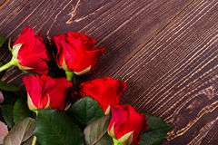 Roses on wooden surface. Royalty Free Stock Photo