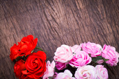 Roses on wooden table Stock Photo
