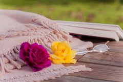 Roses on wooden table. stock images