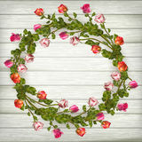 Roses wreath on wooden background. EPS 10 Royalty Free Stock Images