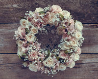 Roses wreath on wooden background. Stock Photography