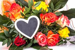 Roses with writing board in heart shape Stock Photography