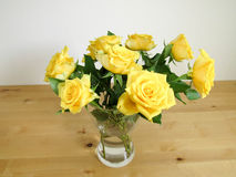 Roses. Yellow rose water table wood glass romance love room Royalty Free Stock Photography
