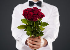 Roses for you. Man giving bouquet of red roses Stock Photography
