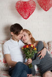 Roses and young couple Stock Photography