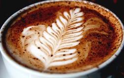 Rosetta im Kaffee-Mokka Stockbild