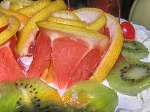 Rosette of beautiful, juicy grapefruit surrounded by kiwi stock photography