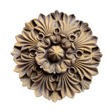 Rosette (carved in wood). Rosette carved in wood, isolated on white background with clipping path royalty free stock image