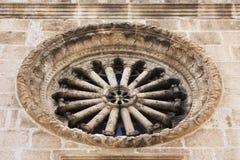 Rosette on the church in Vodice, Dalmatia. Stone rosette on the church in Vodice, Dalmatia royalty free stock photo