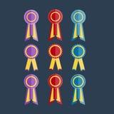 Rosette de pourpre, rouge et bleue de récompense avec le ruban Photographie stock