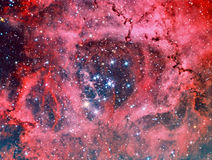 Rosette nebula in Monoceros NGC2244. Astrology astronomy cluster comet constellation cosmos galaxy light royalty free stock photos