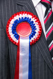 Rosette on suit close up. royalty free stock photos