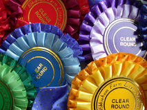 Rosettes. Equestrian colored rosetts royalty free stock image