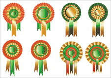 Rosettes. Red green and goid ribbon rosette awards Royalty Free Stock Photos
