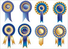 Rosettes. Blue and goid ribbon rosette awards Stock Photo