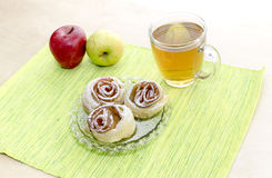 Rosettes from apples in puff pastry Stock Photos
