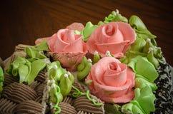 Rosettes creamy on cake Royalty Free Stock Image