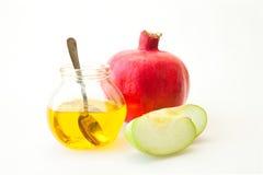 Rosh hashana蜂蜜石榴和苹果 图库摄影