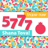 Rosh hashana greeting card - Shana tova 5777. Rosh hashana - Jewish New Year 5777 greeting card with abstract pomegranate, sweet life symbol. Greeting text Shana Stock Photography